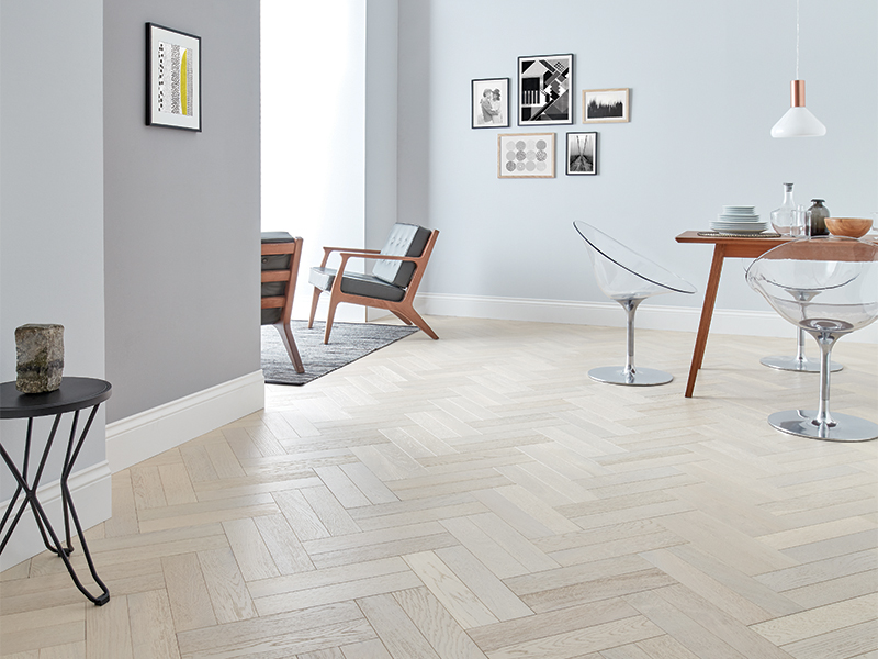 white wood flooring in parquet style