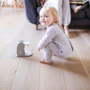 little girl playing on wood floor