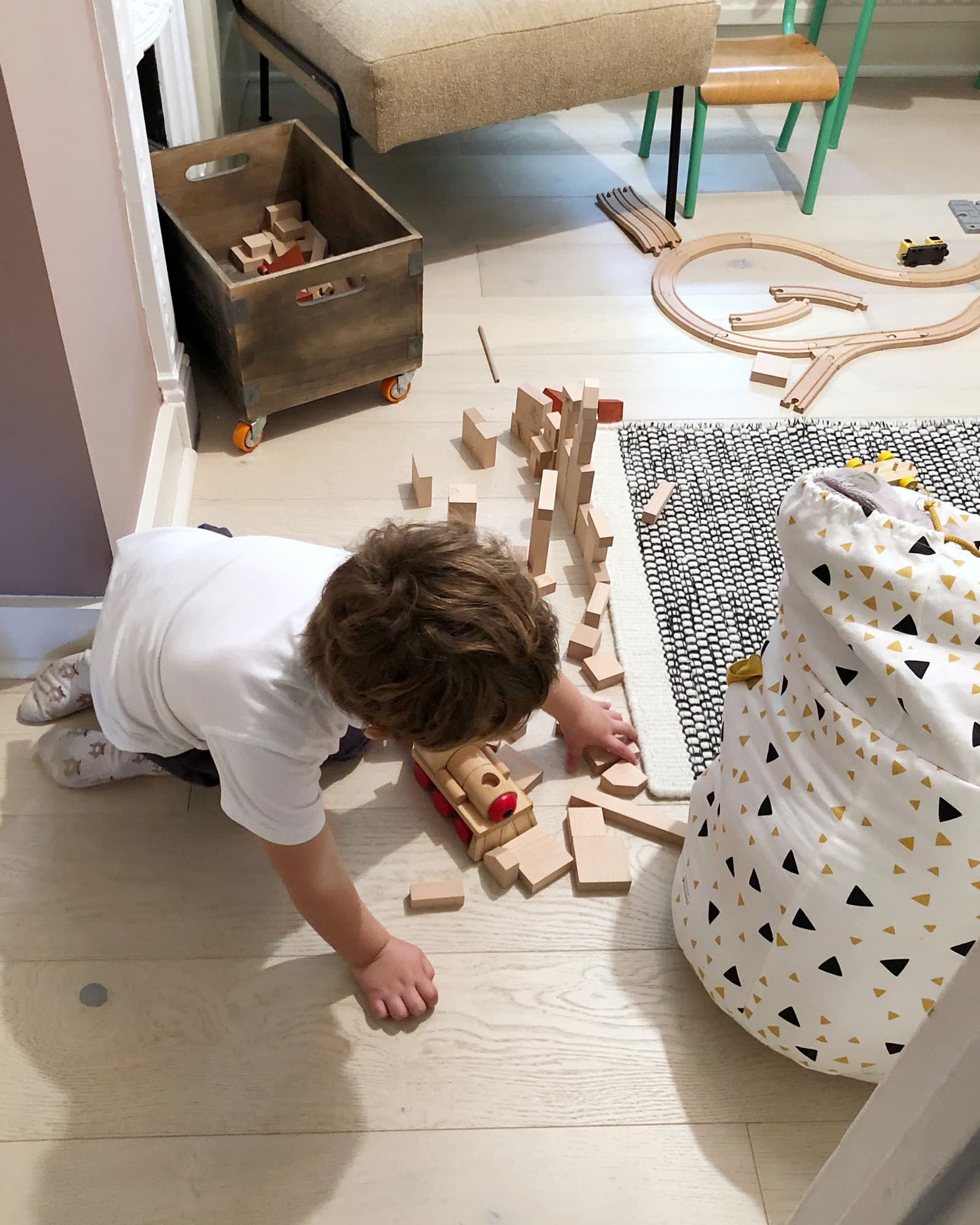 child playing on wood flooring