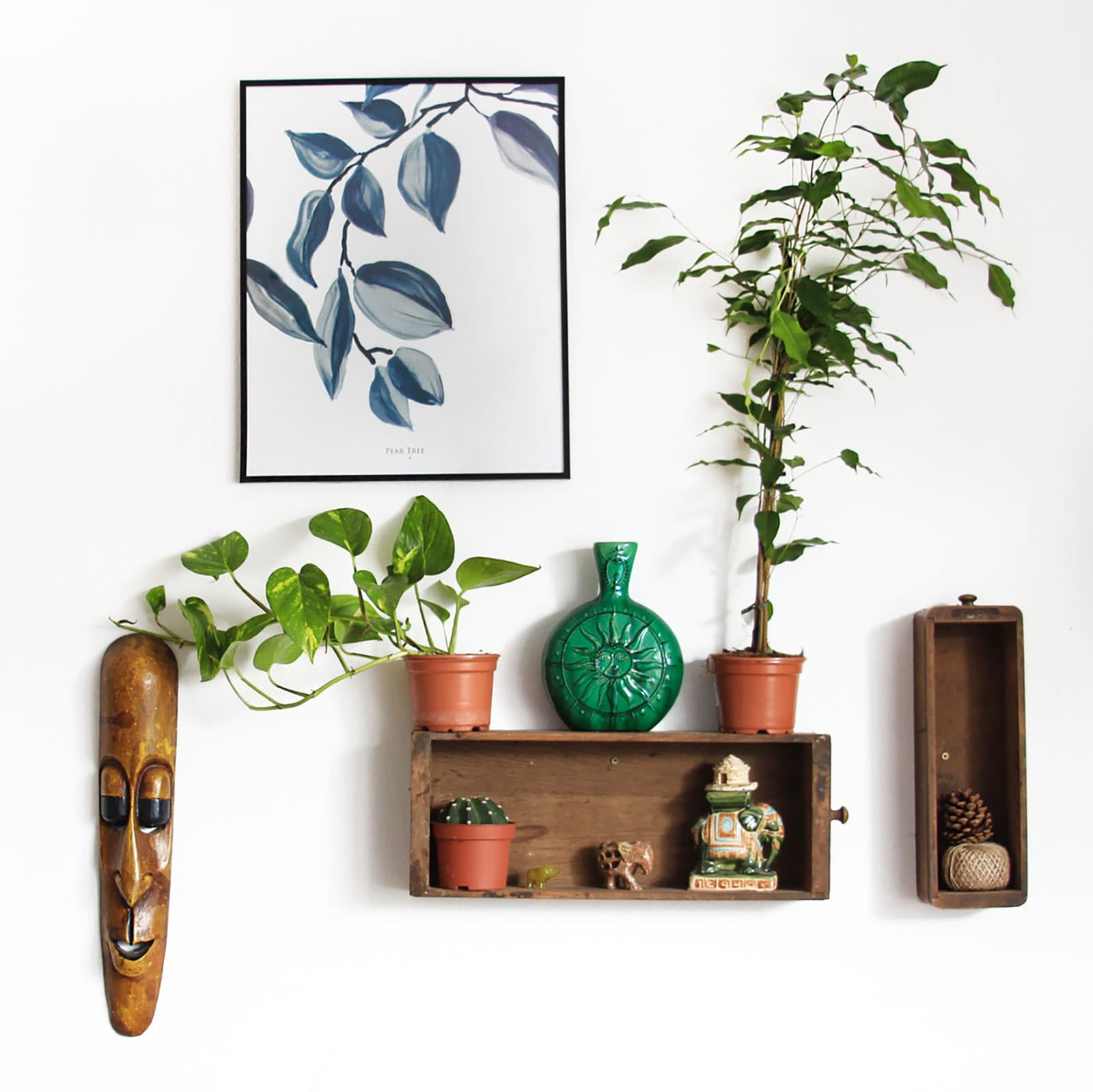 collection of handmade objects on the wall