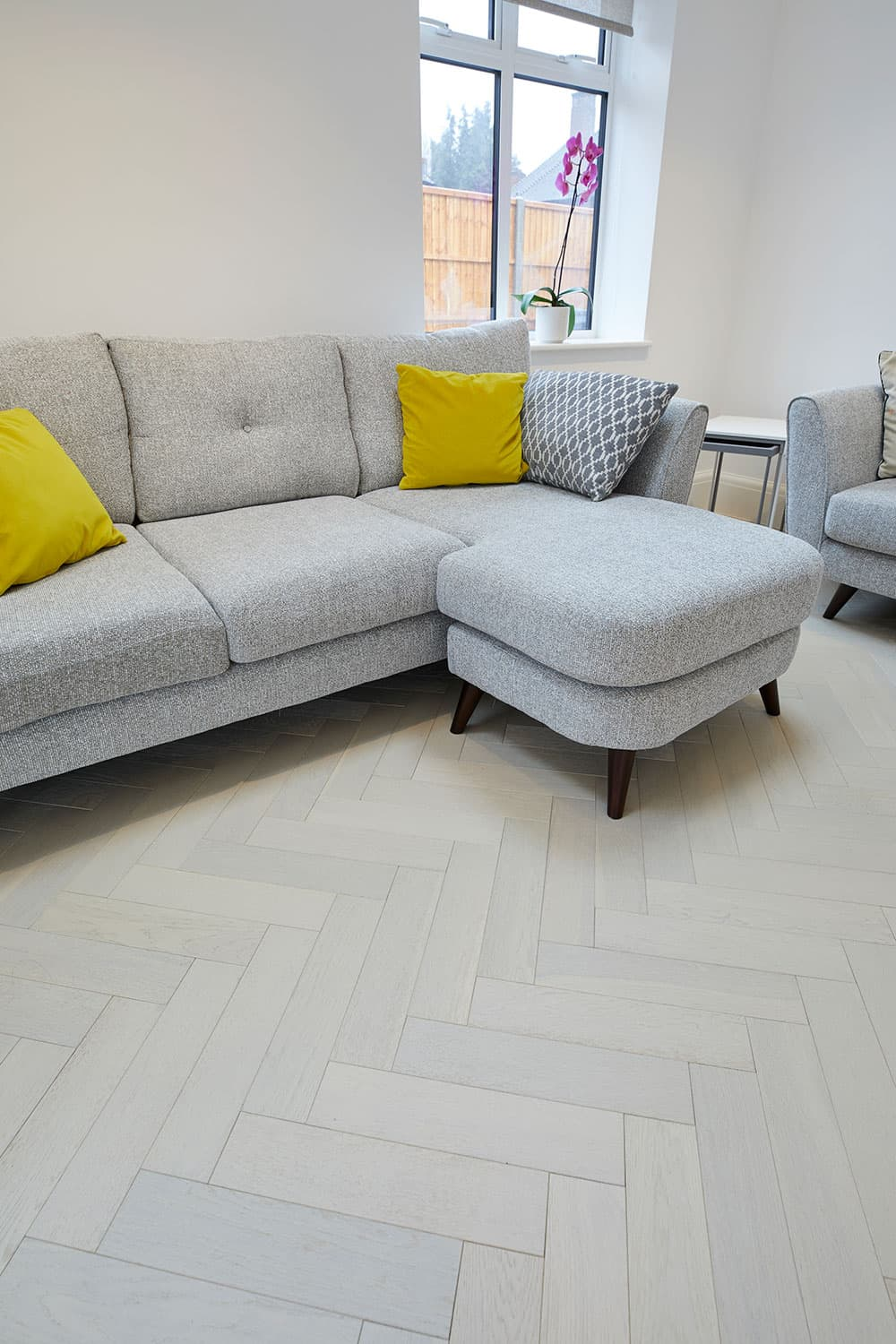 white oak flooring with grey sofa