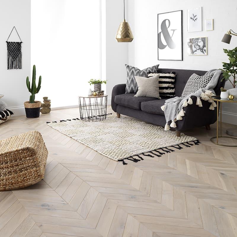 living room with chevron flooring